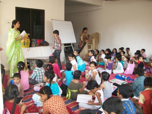Ananga Manjari mataji and Moneshwari mataji telling stories to the kids